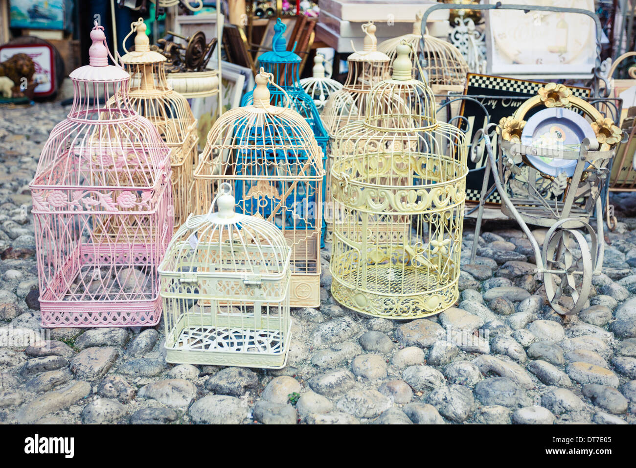 Candid shot of shabby chic vintage cages on a flea market - Stock Image