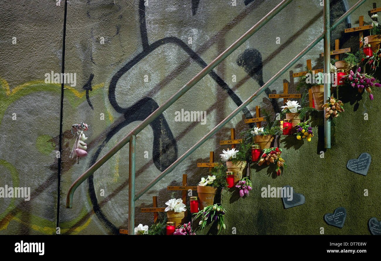 Duisburg, Germany. 10th Feb, 2014. Candles, flowers and commemorative stones commemorate the people who died in Stock Photo