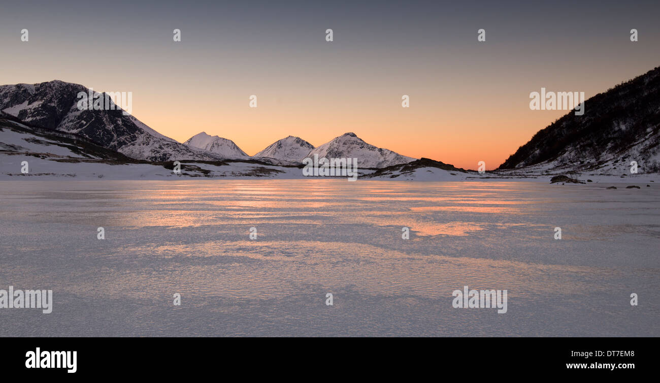 A frozen fjord in the mountains near Tromso in Norway - Stock Image