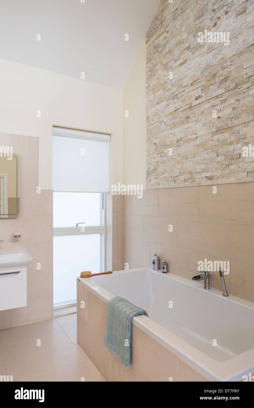 Luxury bathroom with Mandarin Stone tiling and floor Stock Photo ...