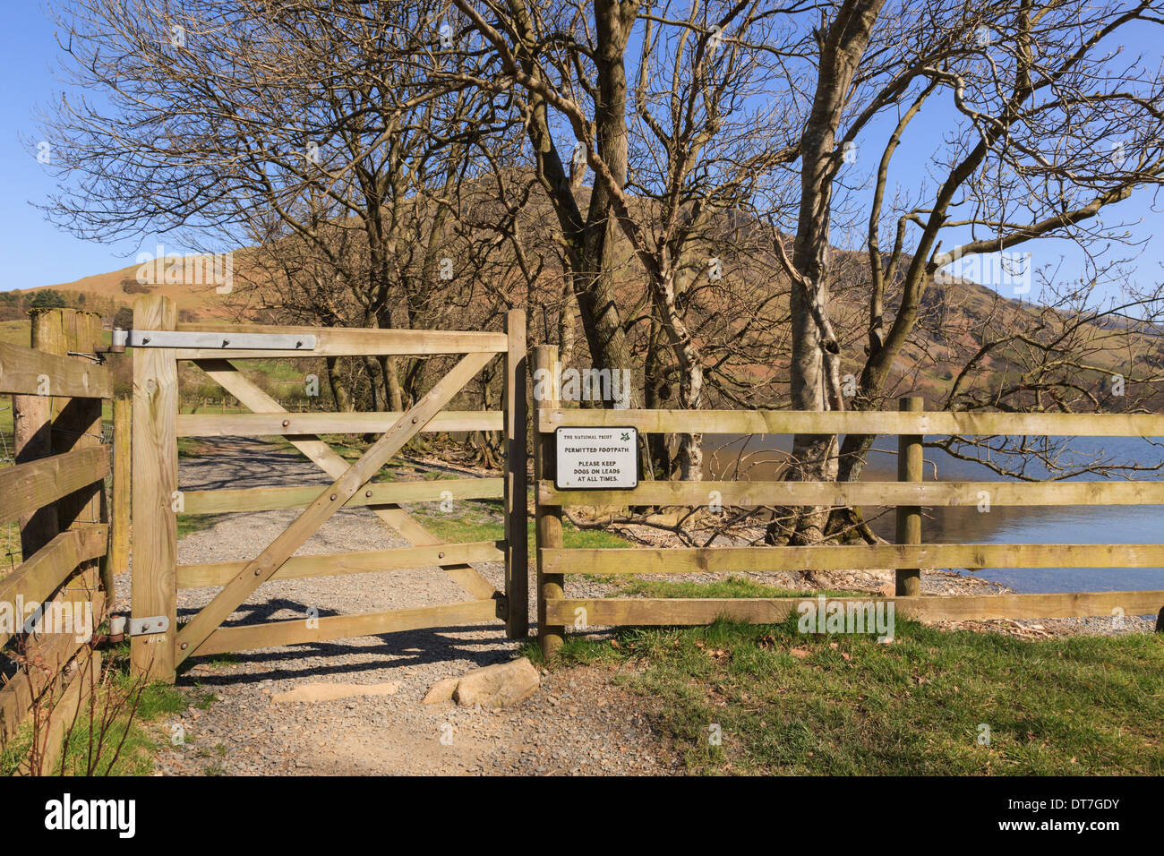 Gate with sign for gated Permitted Footpath around Lake Buttermere in Lake District National Park Cumbria England UK Britain - Stock Image