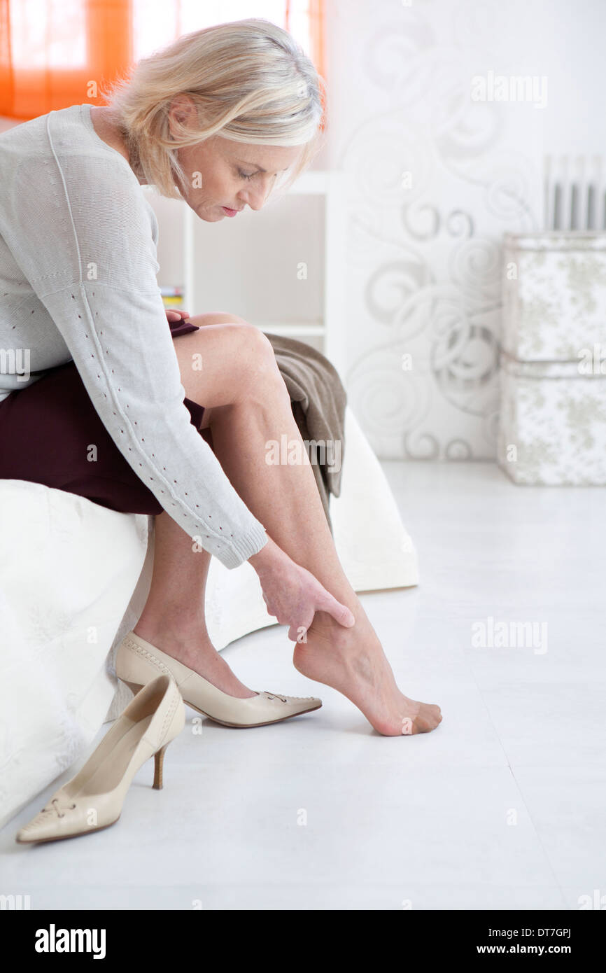 ANKLE PAIN IN A SENIOR - Stock Image