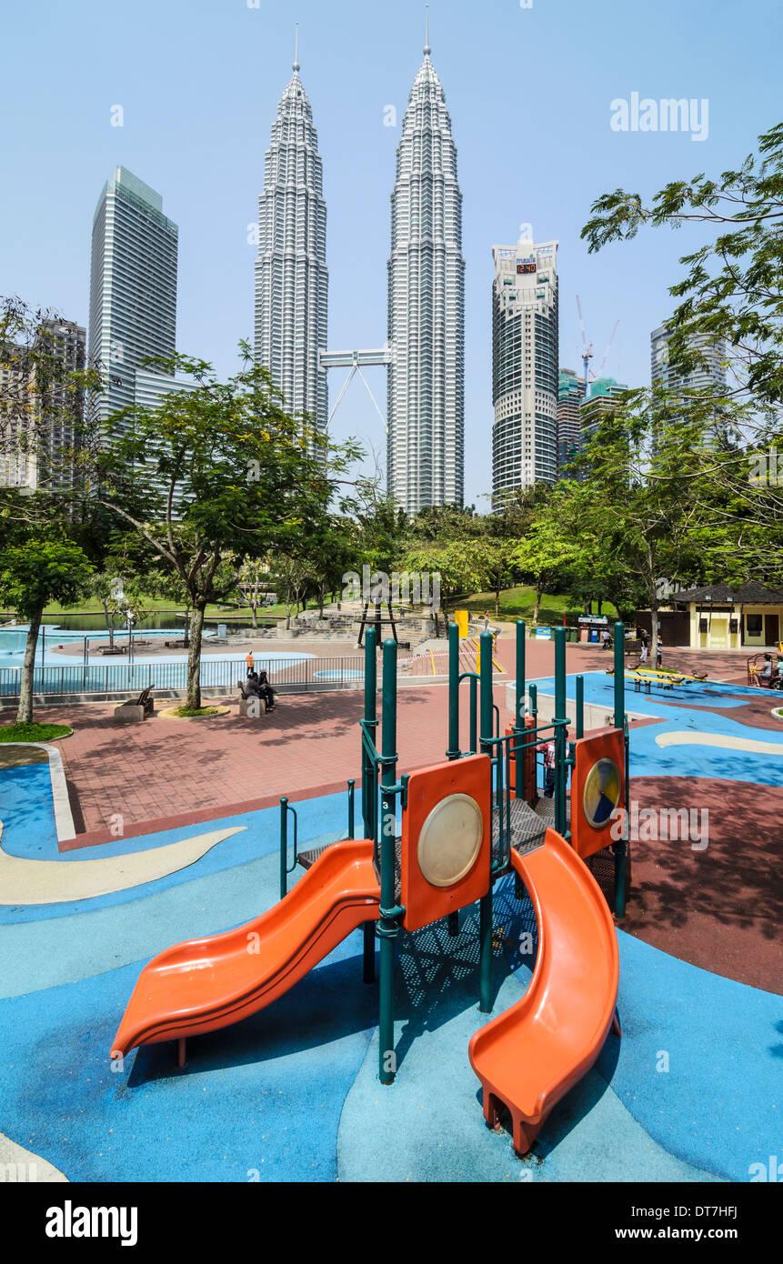 KLCC playground behind the Petronas Towers, Kuala Lumpur, Malaysia - Stock Image
