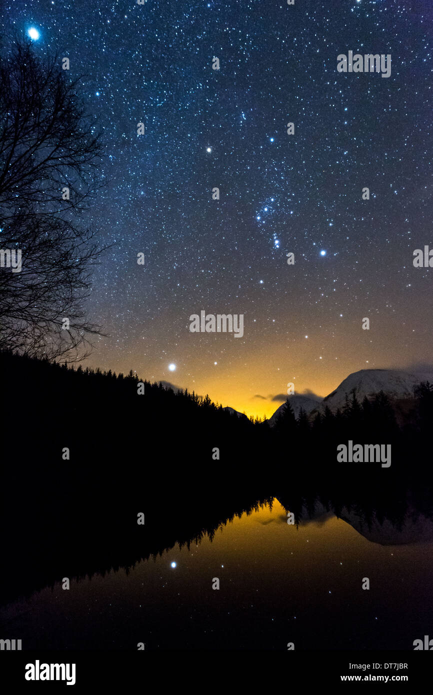 Astronomy photograph showing the constellation of Orion & Orion Nebula, Sirius, Jupiter reflected in Glencoe - Stock Image