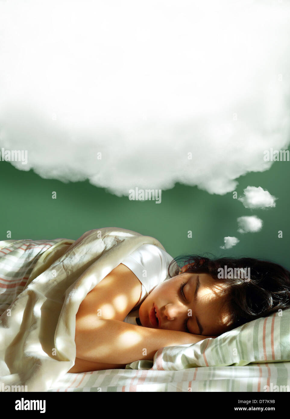 Young Girl Sleeping In Her Bed With A Dreaming Fluffy Balloon Above Head