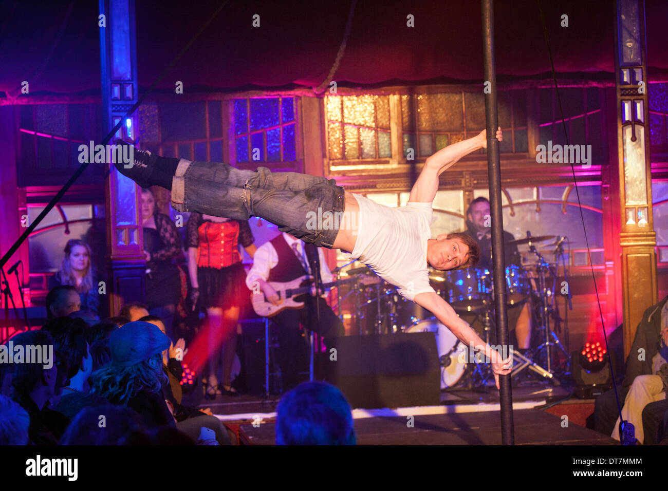 Big Burns Supper 2014, Dumfries, Le Haggis, Edd Muir Cabaret pole dancing. Upper body strength balance acrobat strong - Stock Image