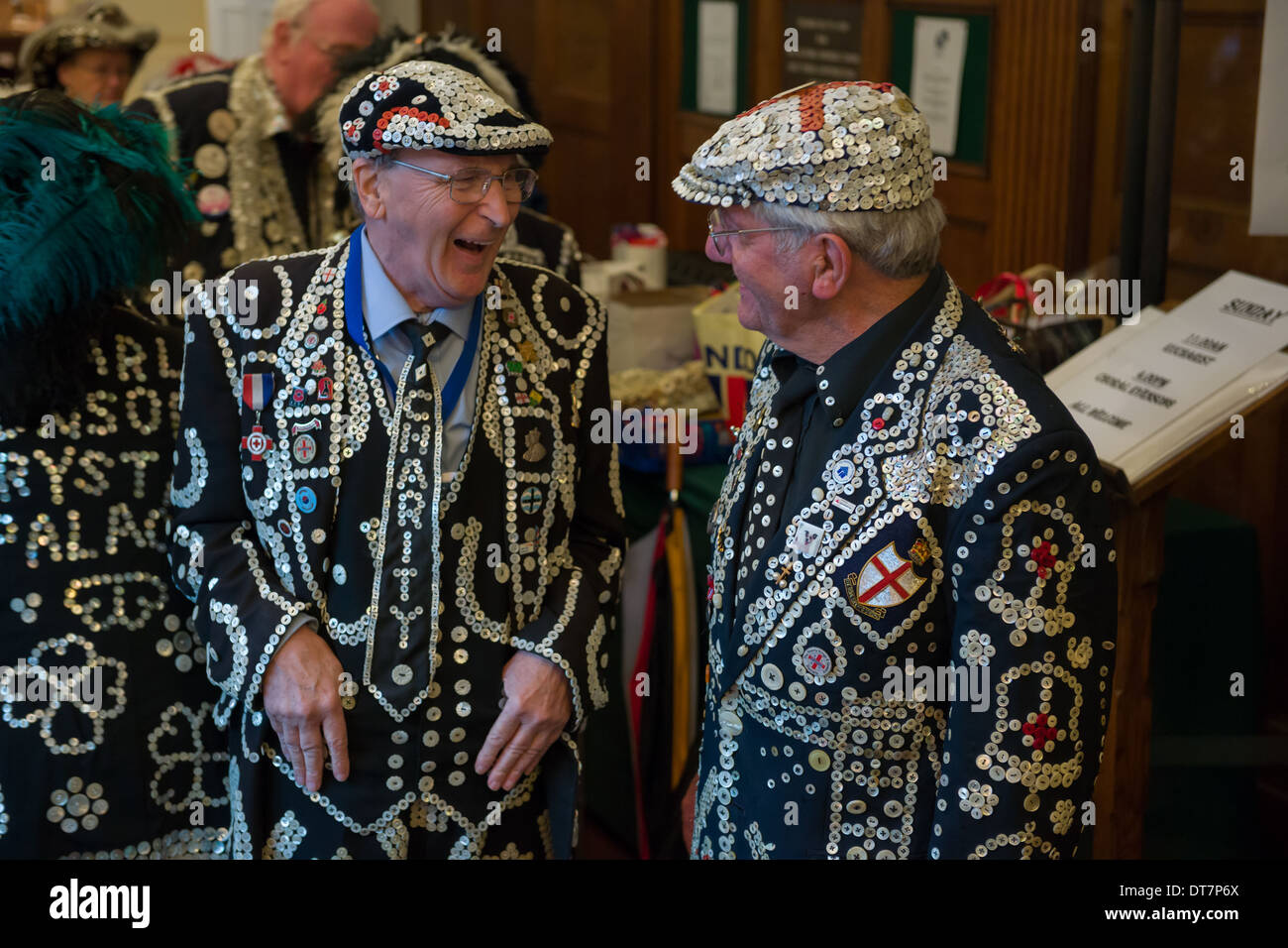 Pearly Kings chatting before the London Pearly Kings and Queens second Harvest Festival, St Paul's Church, Covent Garden, London, England - Stock Image