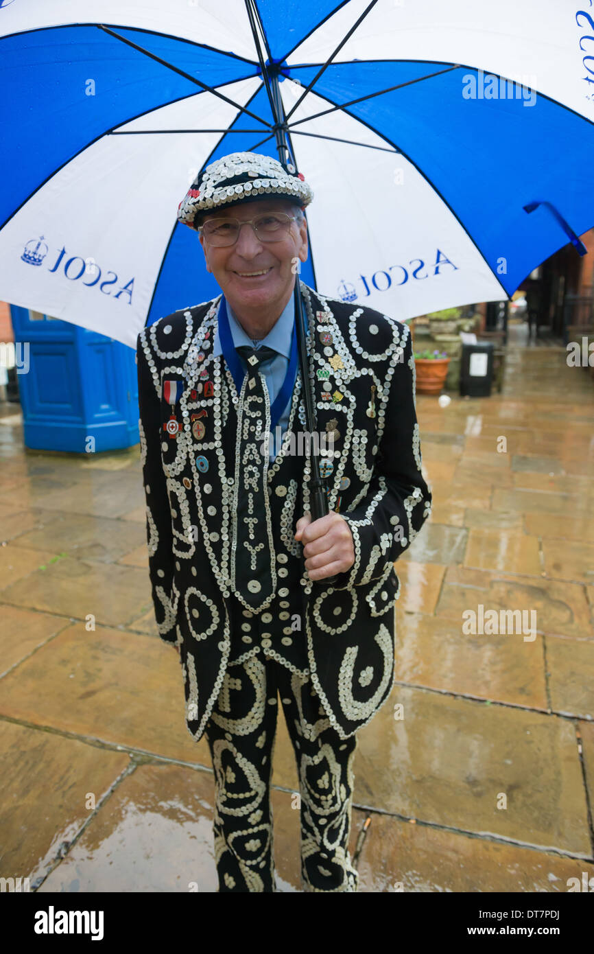 Pearly King with an umbrella arriving for the London Pearly Kings and Queens second Harvest Festival, St Paul's Stock Photo