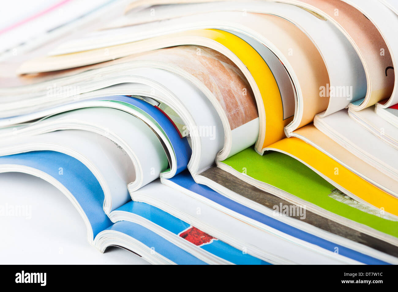 Pile of colorful paper magazines - Stock Image