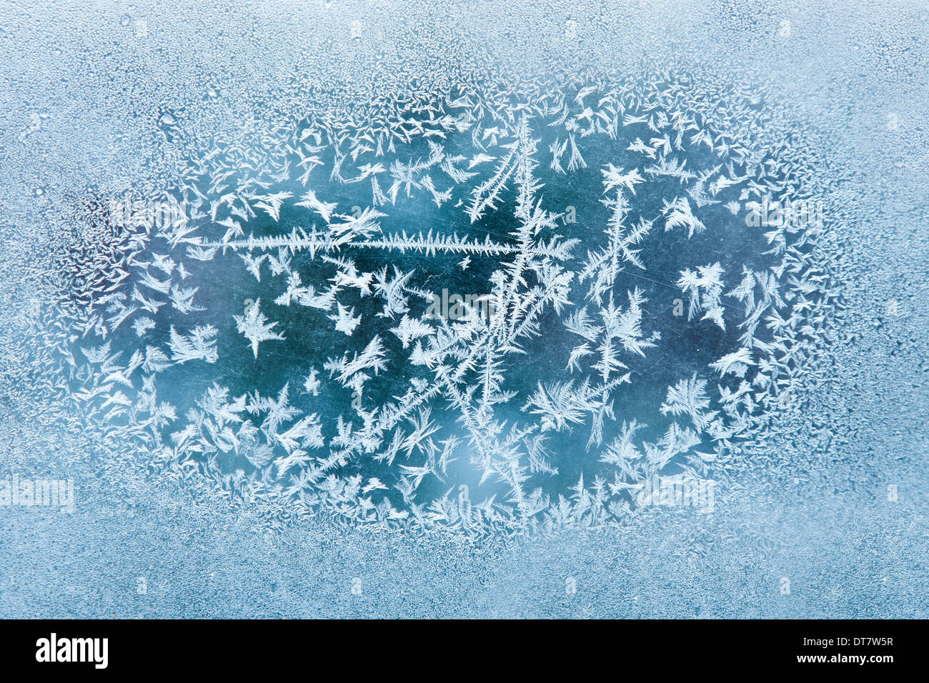 Frost on the old scratched glass, texture. Focus on center - Stock Image