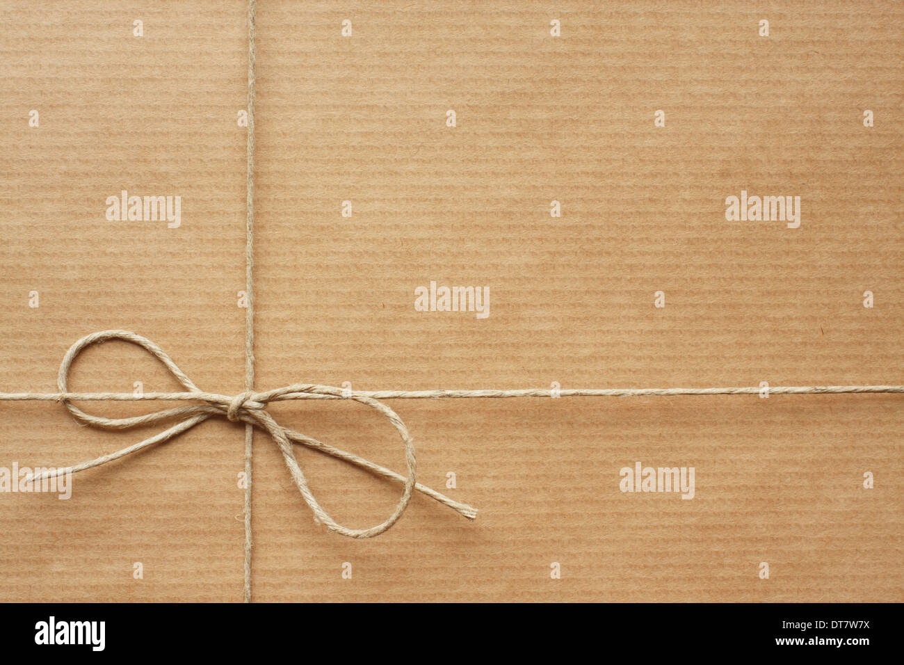 Pack wrapped in wrapping paper, tied with string. Empty space for Your text - Stock Image