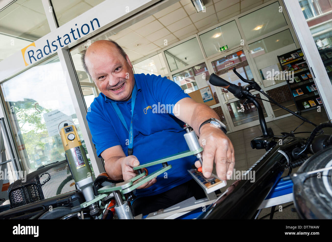 A technician of the ADFC bikers club encodes a bike. - Stock Image