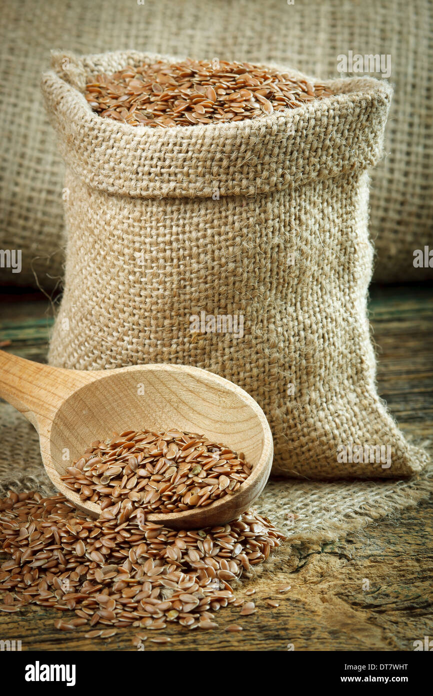 Flax seed (linseed) in a burlap bag - Stock Image