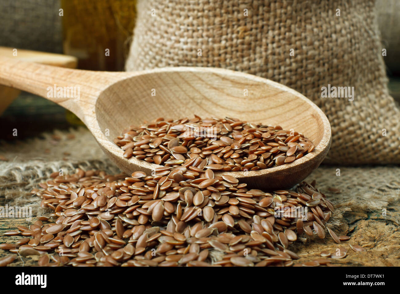 Flax seed (linseed) on wooden spoon - Stock Image