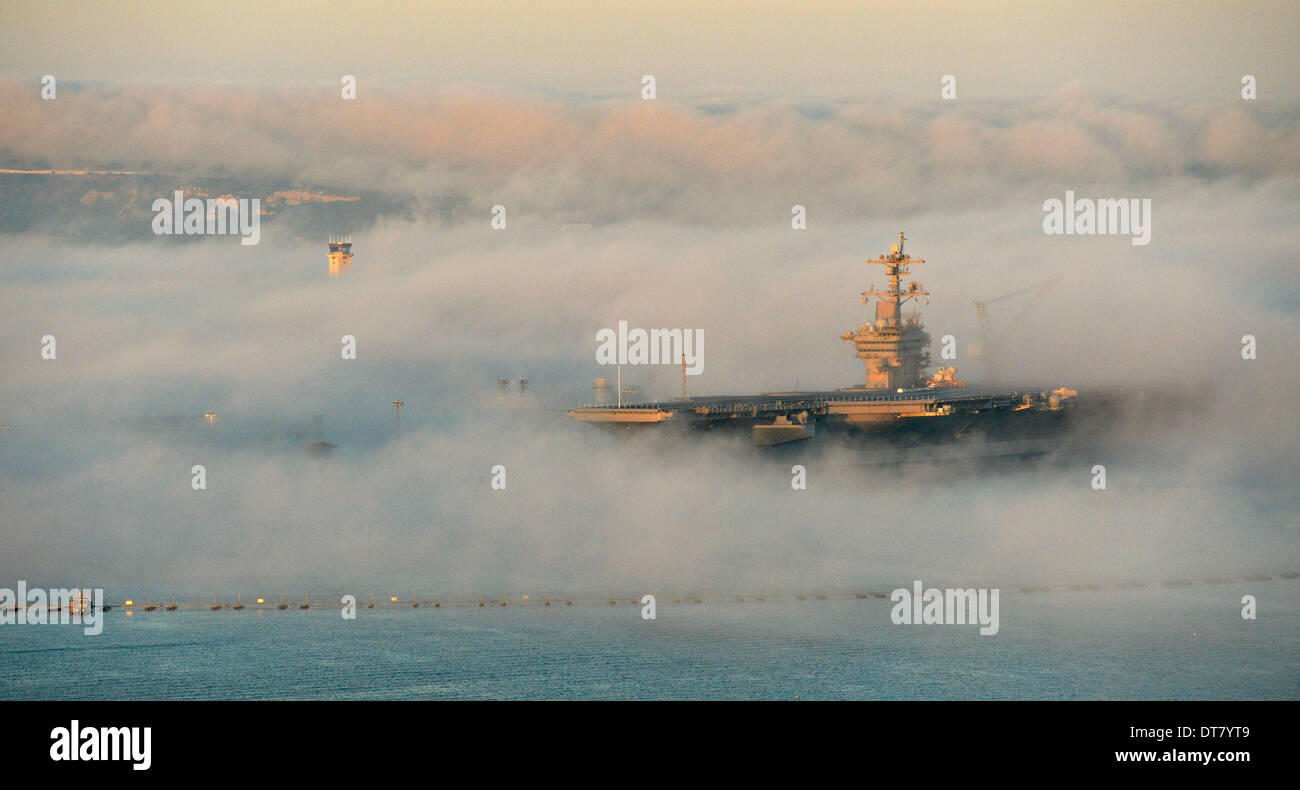 San Diego, CA, USA . 11th Feb, 2014. The US Navy nuclear aircraft carrier USS Carl Vinson is enveloped in fog as she sits at her berth February 11, 2014 in San Diego, CA. Credit:  Planetpix/Alamy Live News - Stock Image