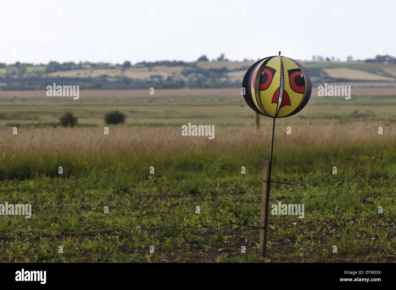 Birdscarer rotating ball with reflective panels and raptor's face attached to post Elmley Marshes N.N.R. Isle of Sheppey Kent - Stock Image