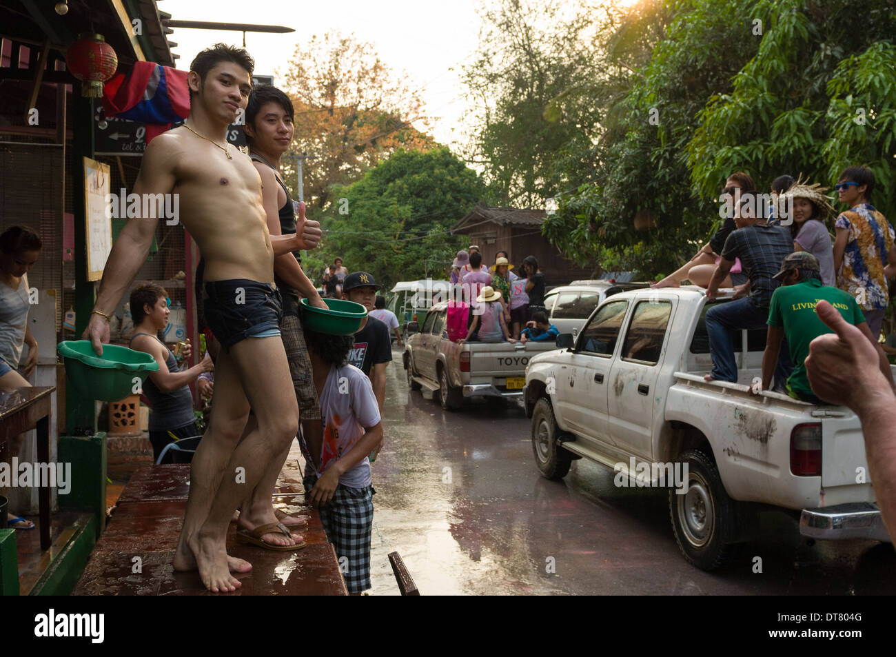 Camp Lao boys taking part in water fights on Mue Nau, the middle day of Lao New Year (Pi Mai Lao), Luang Prabang, Laos - Stock Image