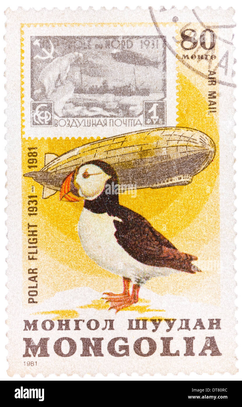 Stamp printed in Mongolia shows the image of the Graf Zeppelin & Puffin from the series 'Polar Flight - Stock Image