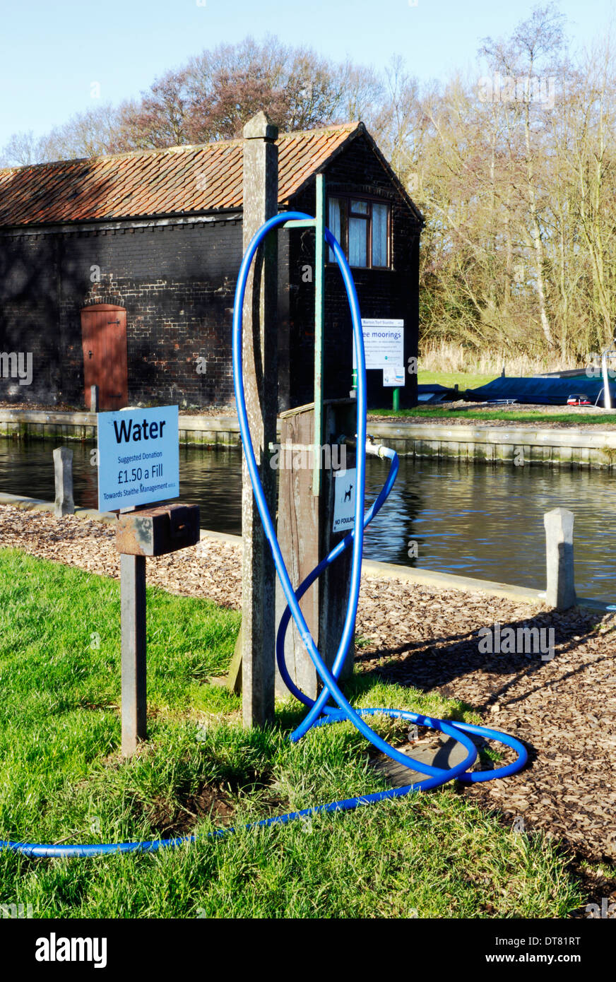 A water fill-up point for Broads craft at Barton Turf Staithe on the Norfolk Broads, England, United Kingdom. - Stock Image