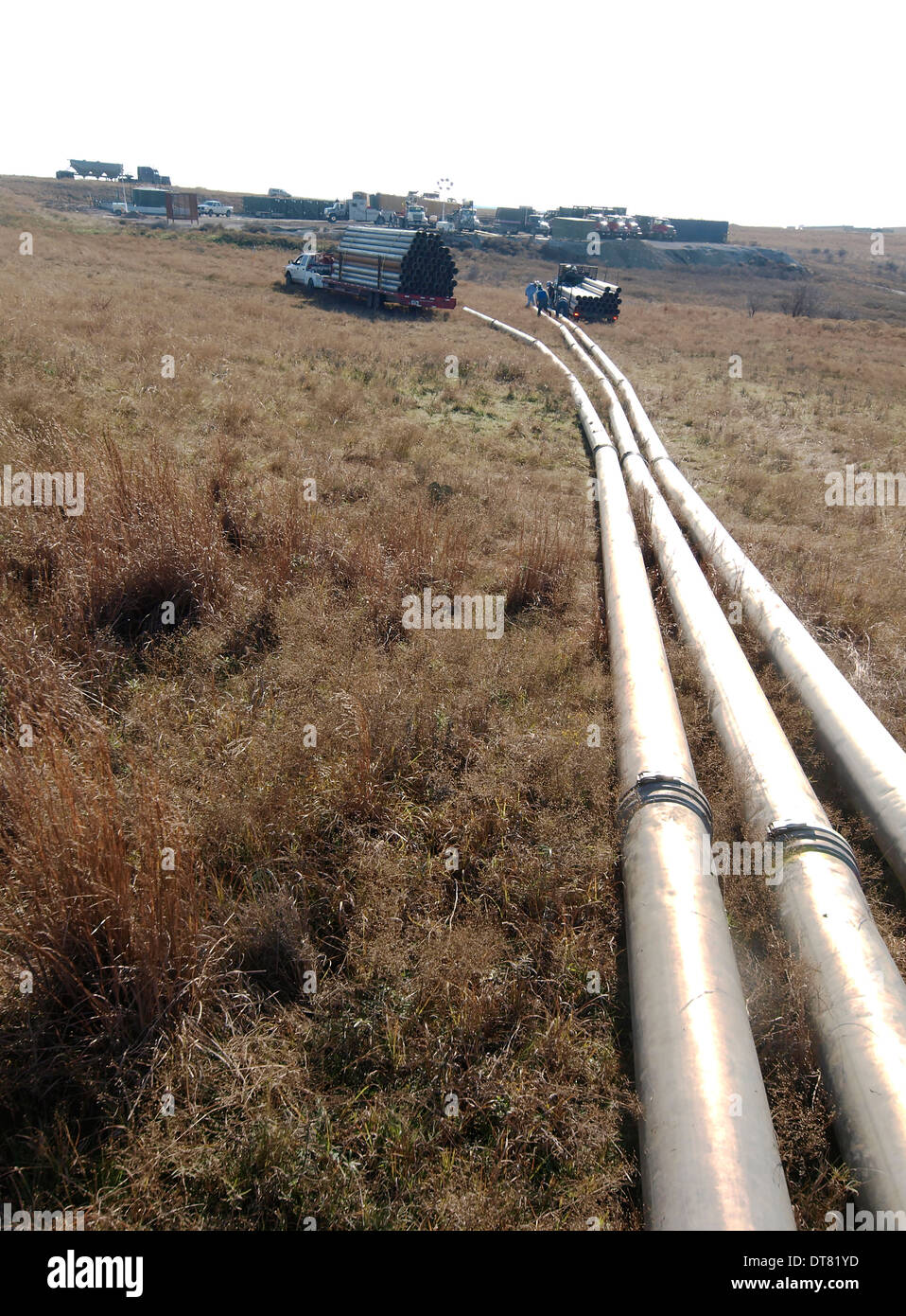 Pipeline brings fresh water to a drilling site to prepare to frack the well and get the oil out. Hydraulic fracturing - Stock Image