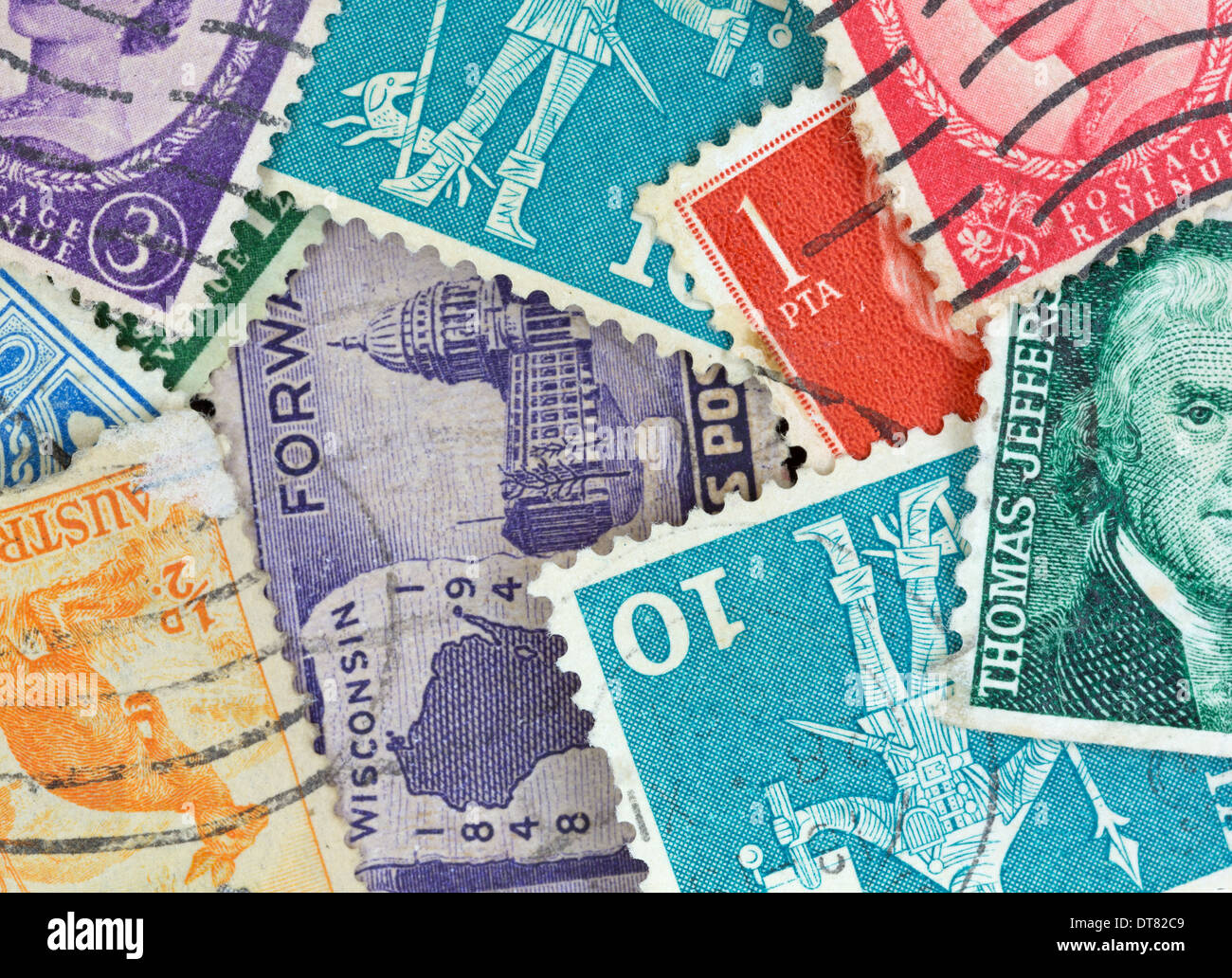 A very close view of several canceled vintage postage stamps. - Stock Image