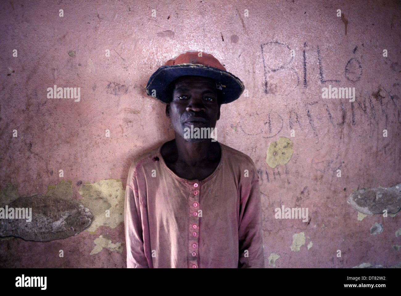 A refugee takes shelter in an old school. Angolan Civil War (1975-2002) - Stock Image