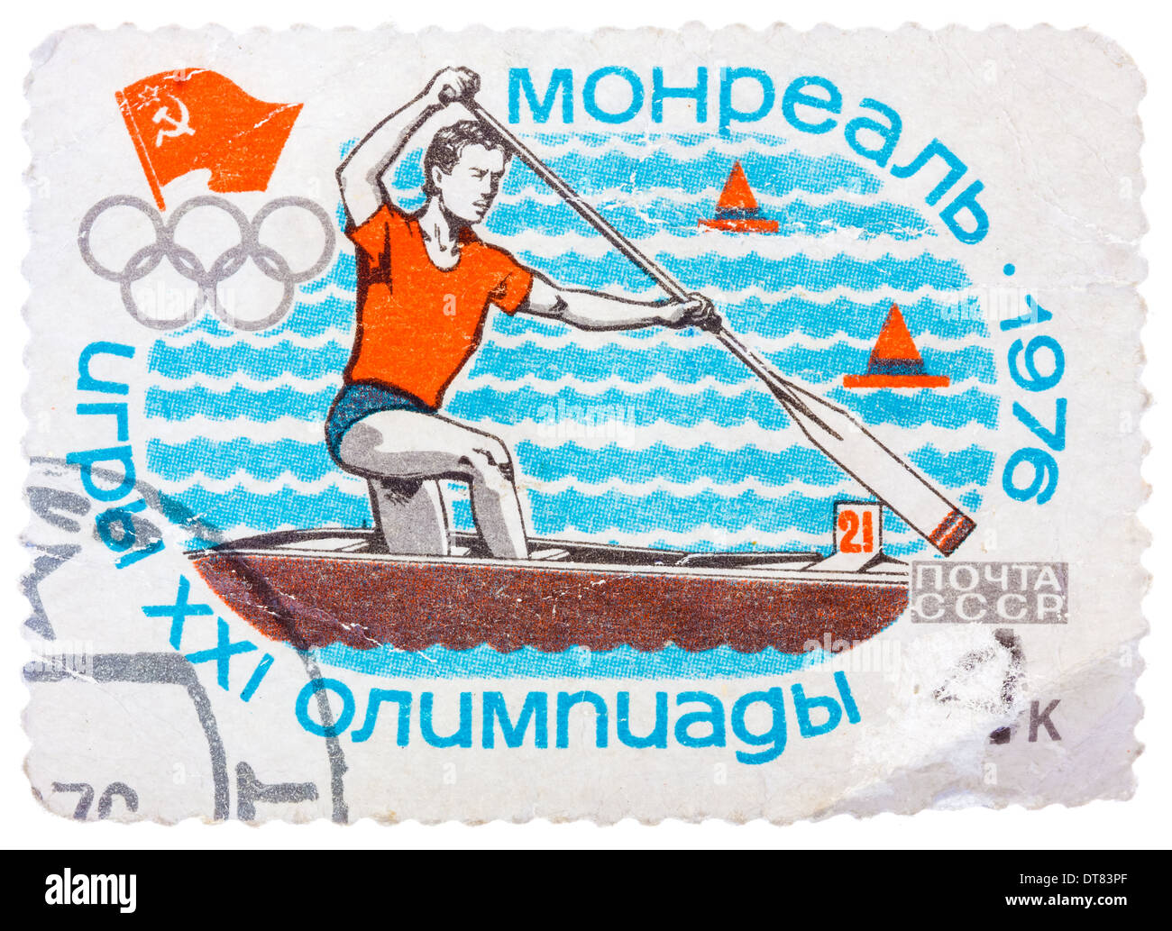 Stamp printed in Russia (Soviet Union), Summer Olympics in Montreal, canoeing, athlete is swimming in a boat with a paddle - Stock Image