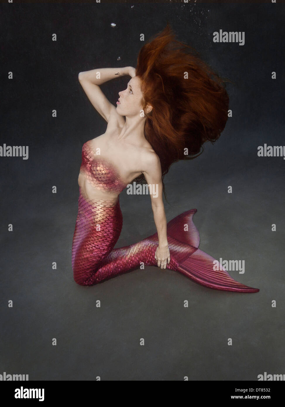 Redhead mermaid underwater in a pool in Virginia Beach, Virginia - Stock  Image