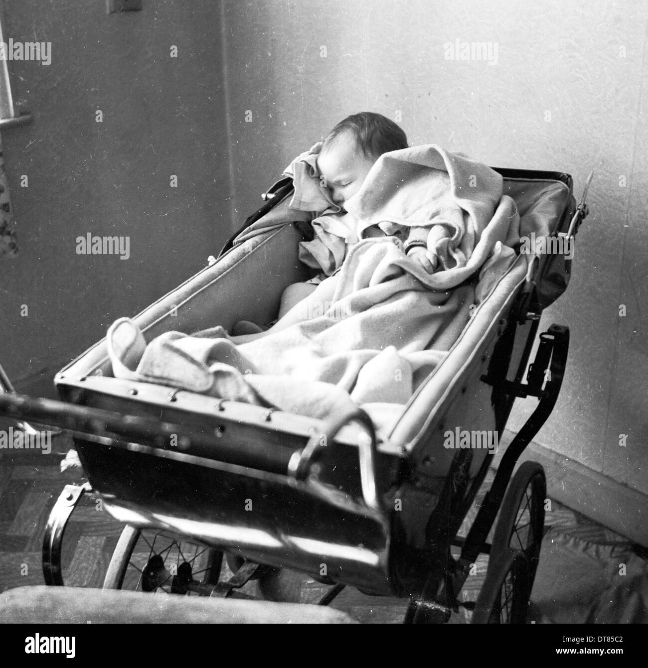 Historical Picture From 1950s Showing A Sleeping Baby In Her Pram