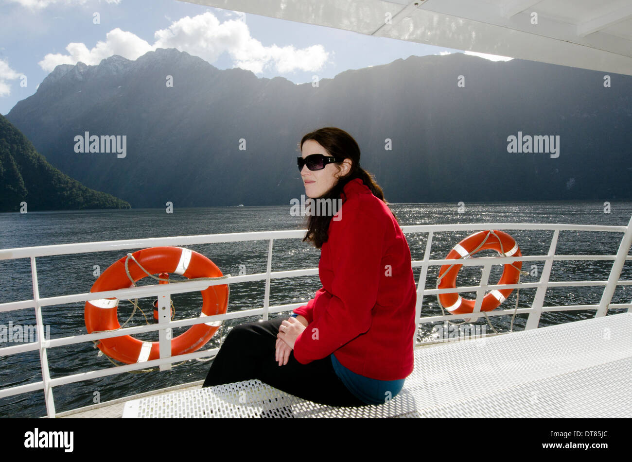 Woman sail on a cruise boat in milford sound, Fiordland, New Zealand. - Stock Image
