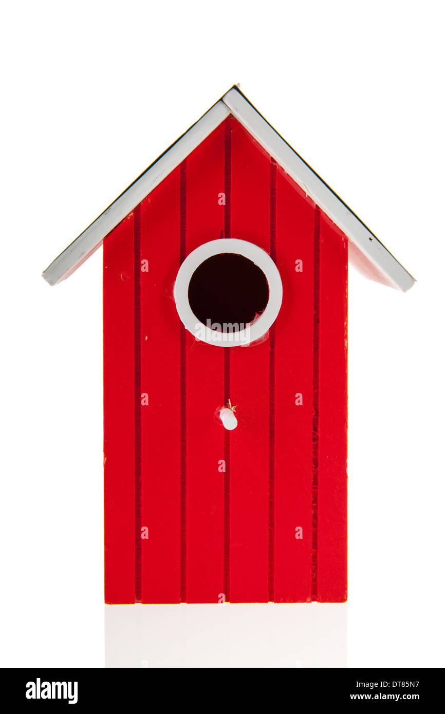 Red bird house isolated over white background - Stock Image