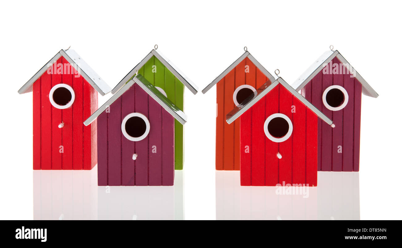 Colorful bird houses in a row isolated over white background Stock Photo