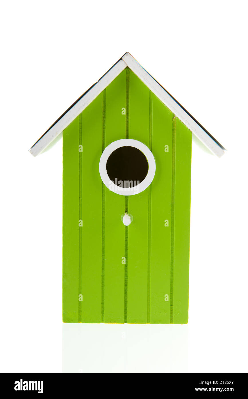 Green bird house with hole isolated over white background - Stock Image
