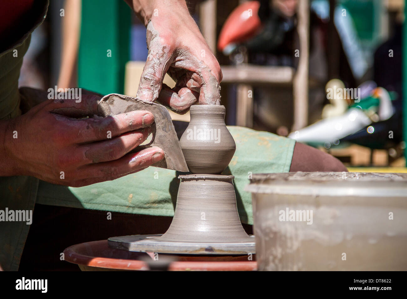 Public shaping handmade pottery on the streets of Warsaw, Poland - Stock Image