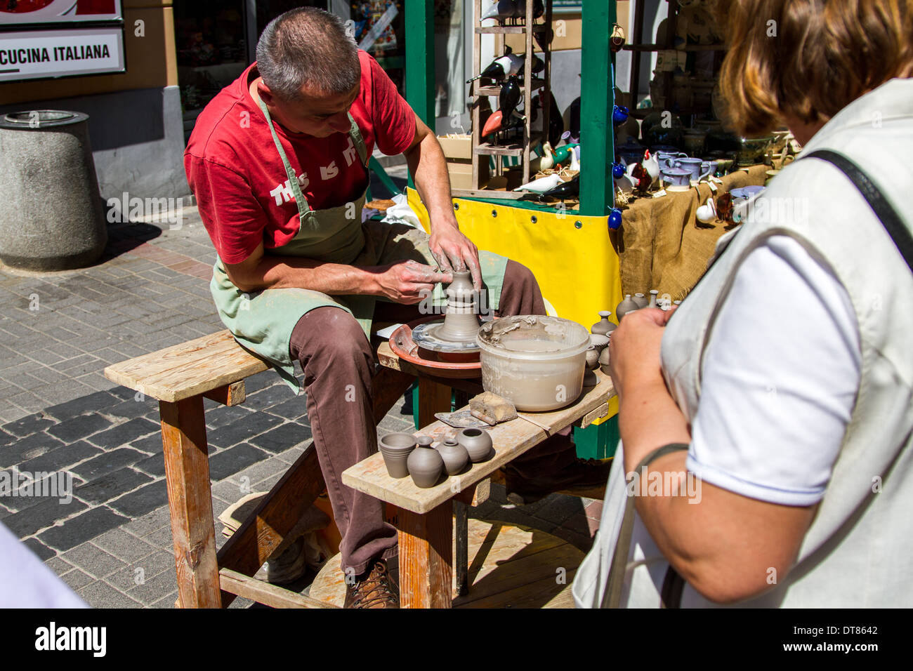 Shaping handmade pottery on the streets of Warsaw, Poland - Stock Image
