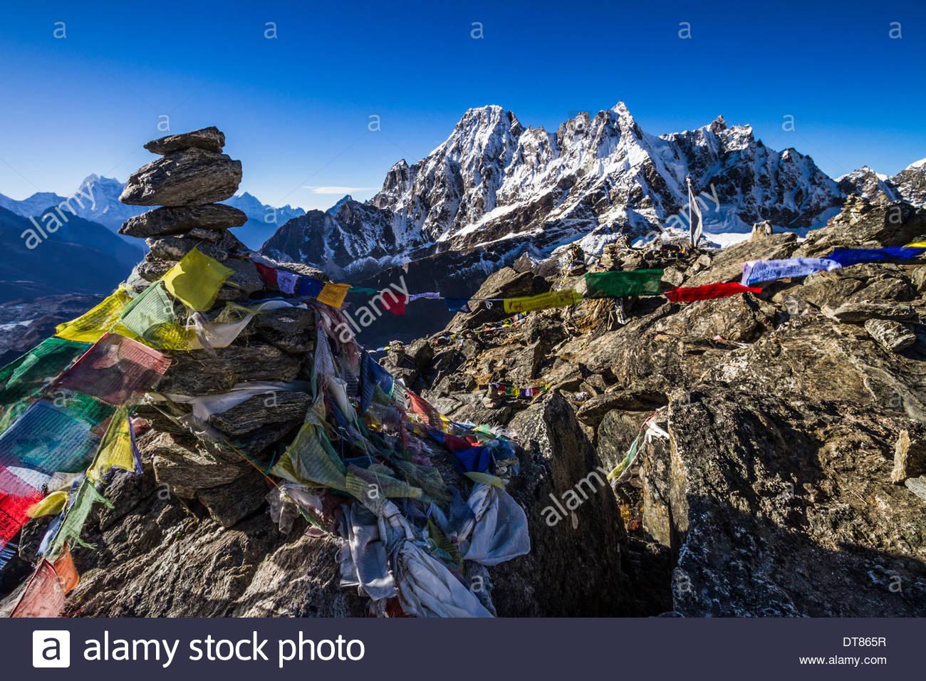 Prayer Flags And The Machermo Range From Gokyo Ri, Nepal - Stock Image