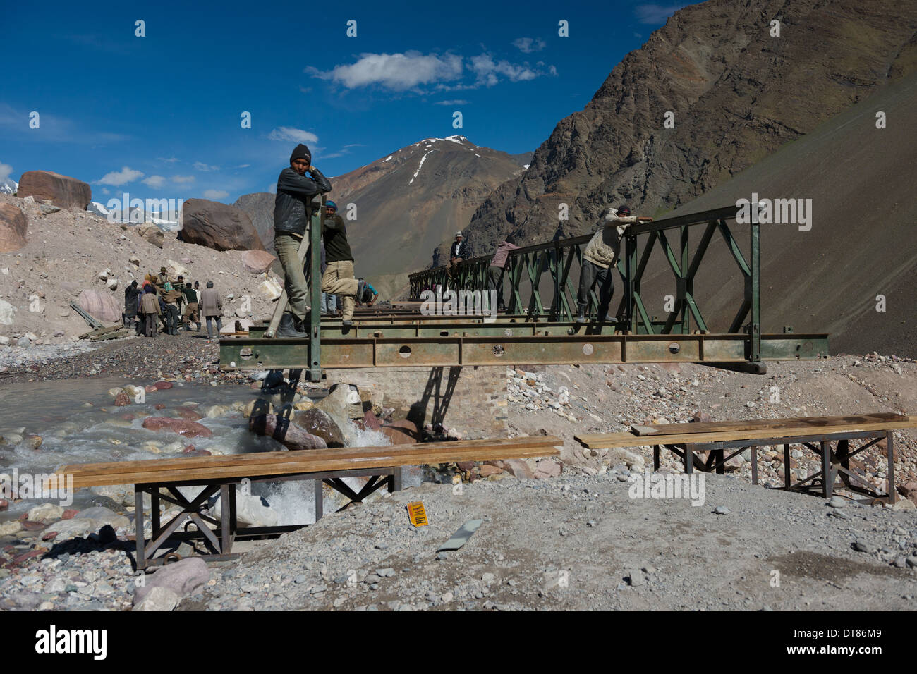 Labourers repairing a Bailey Bridge which was washed away by a flood, on the Leh-Manali Highway, Himachal Pradesh, India - Stock Image