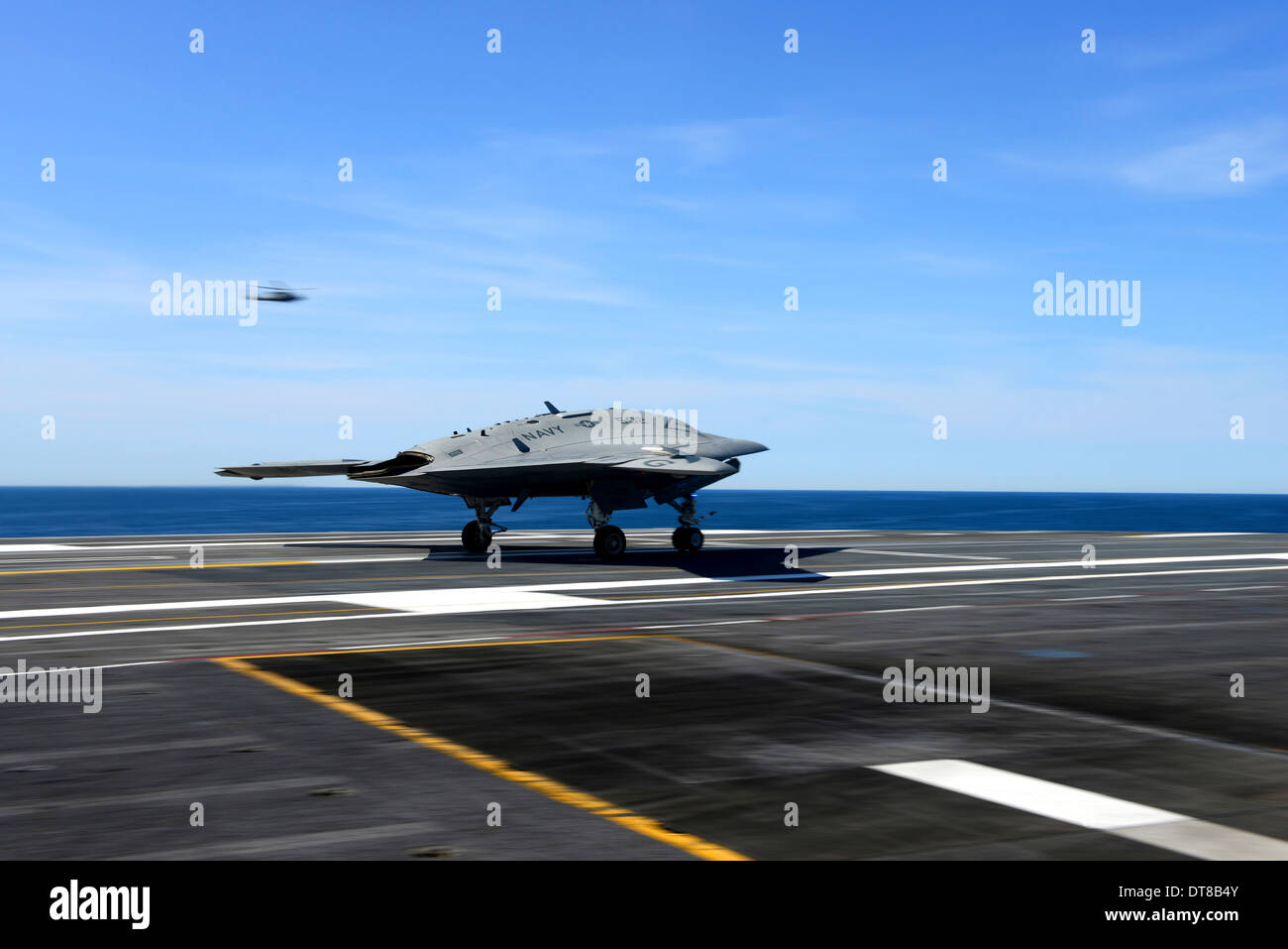 An X-47B unmanned combat air system conducts a touch and go landing. - Stock Image