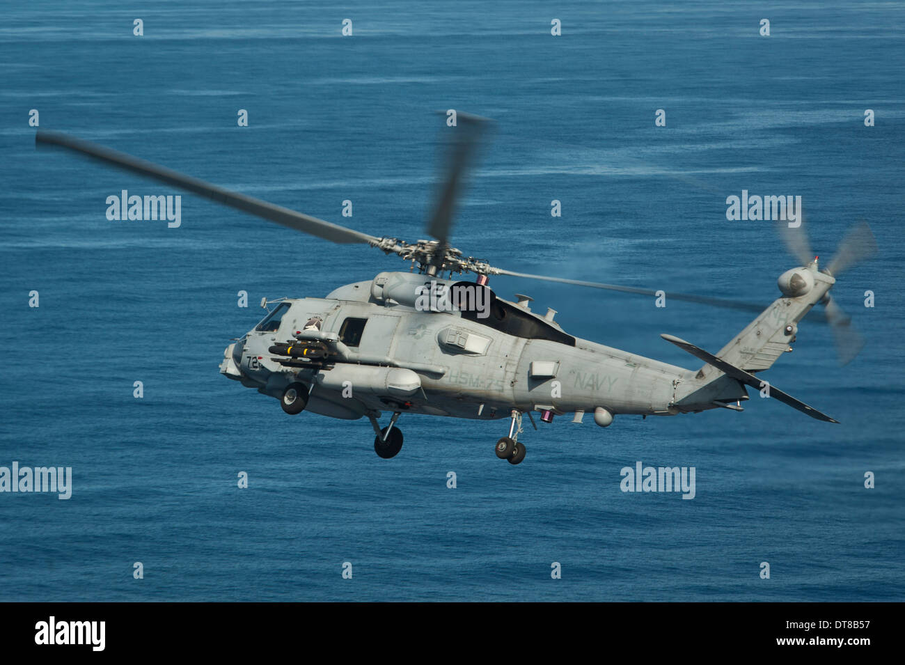 South China Sea, May 18, 2013 - An MH-60R Sea Hawk helicopter maneuvers over the South China Sea. - Stock Image