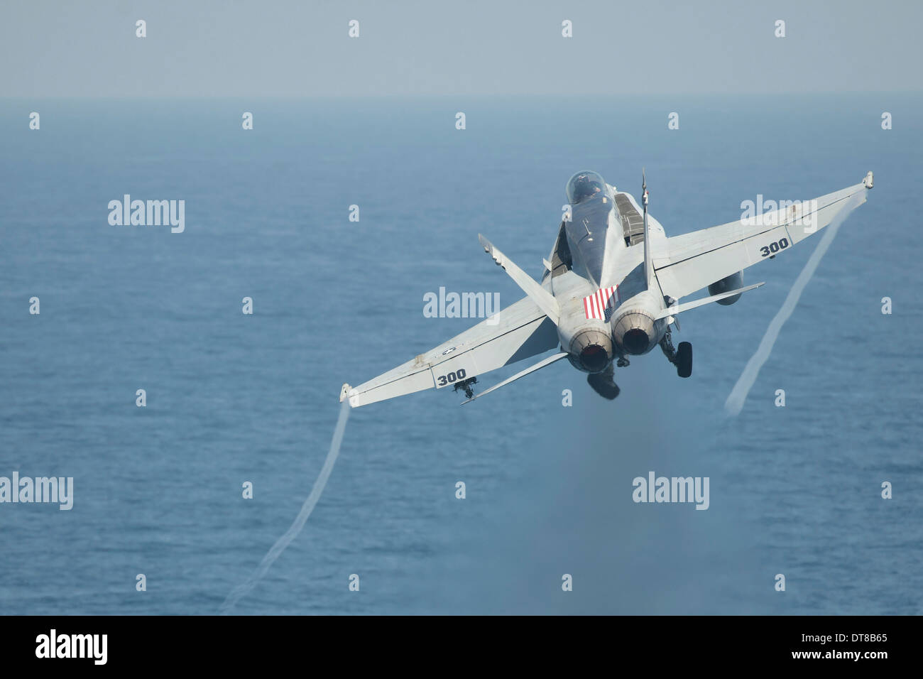 An F/A-18C Hornet taking off. - Stock Image