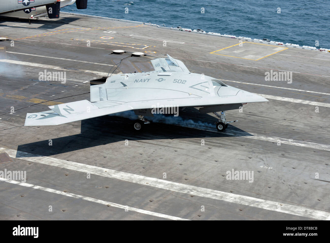 An X-47B Unmanned Combat Air System makes an arrested landing. - Stock Image