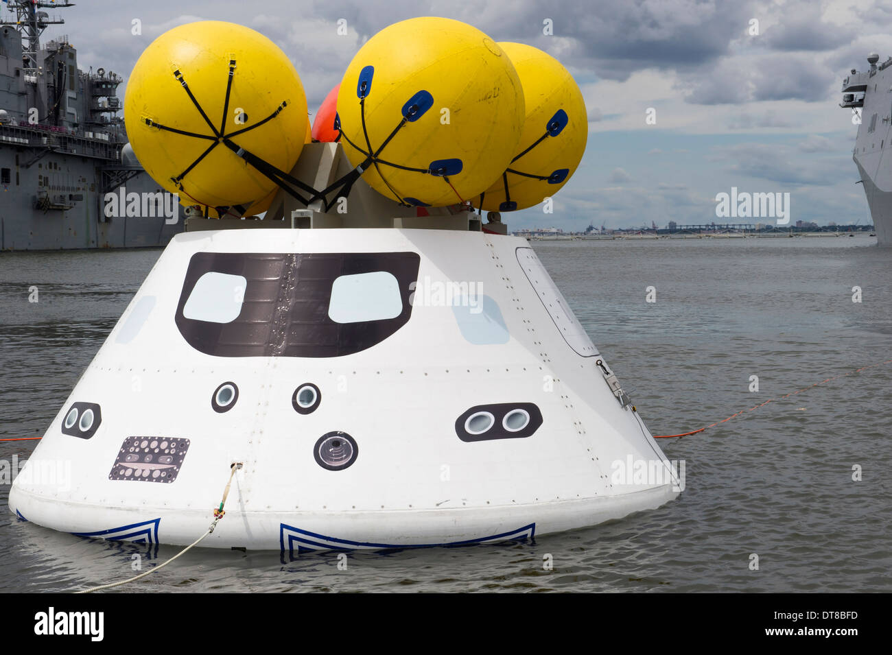 An Orion capsule before being towed into the well deck of USS Arlington. - Stock Image