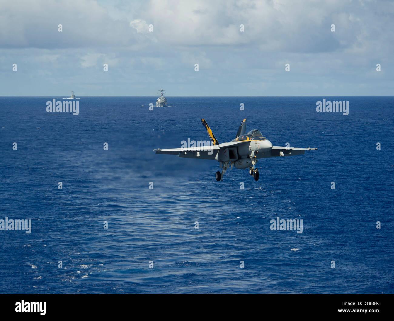 n F/A-18E Super Hornet prepares to make an arrested landing. - Stock Image