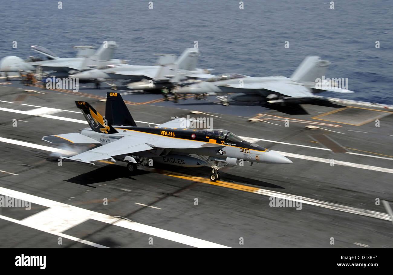 An F/A-18E Super Hornet makes an arrested landing. - Stock Image
