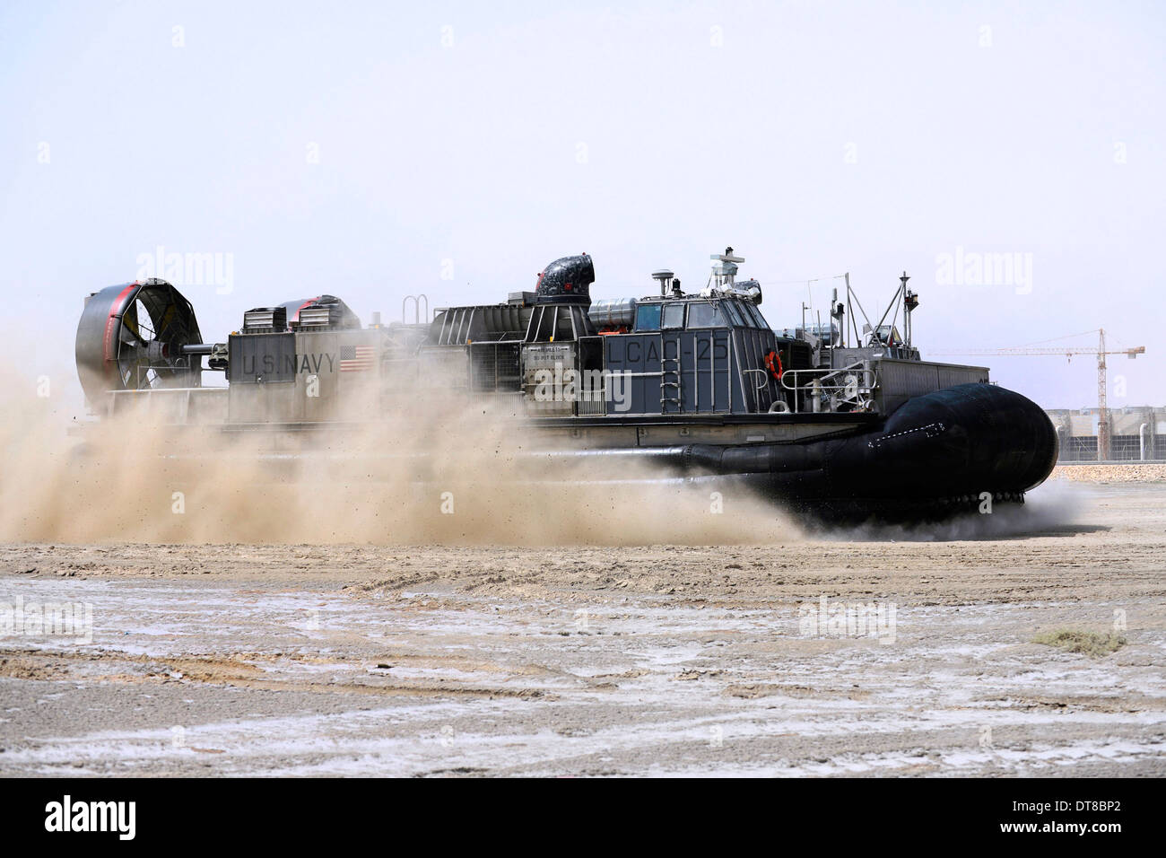 An air-cushion landing craft approaches the shore of Camp Al-Galail, Qatar. - Stock Image