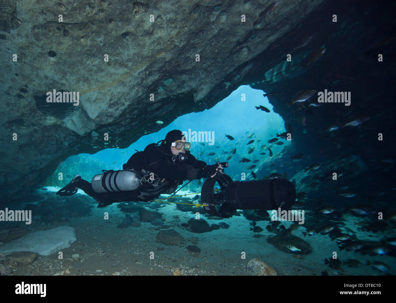 A diver using a diver propulsion vehicle in the Blue Springs cave system. - Stock Image