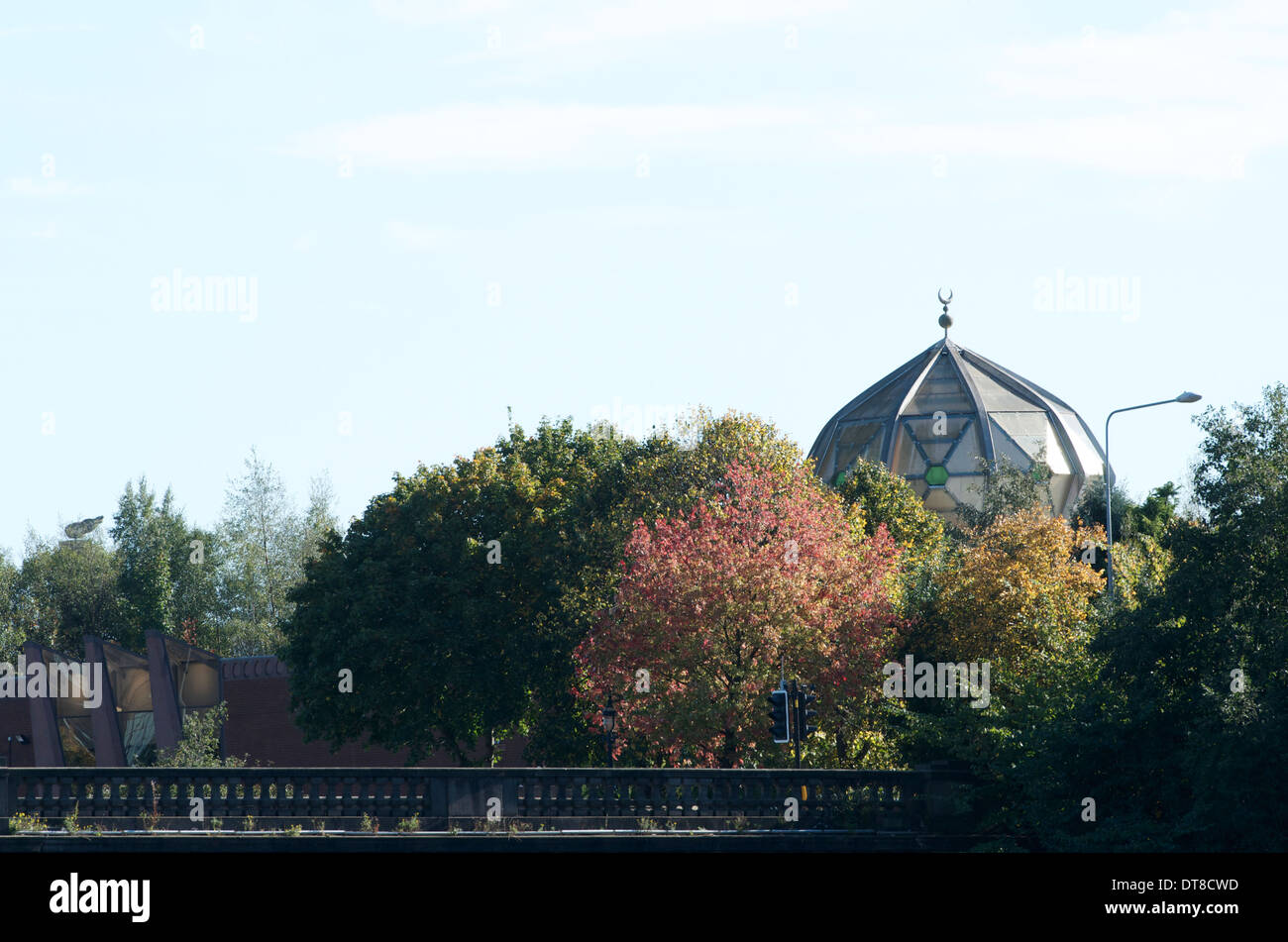 The Dome of Glasgow's Central Mosque rises above its surrounding trees. - Stock Image