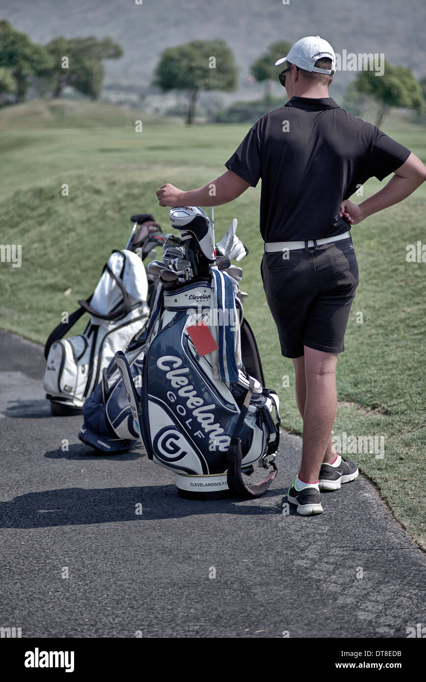 Golf caddy and golfers bag - Stock Image
