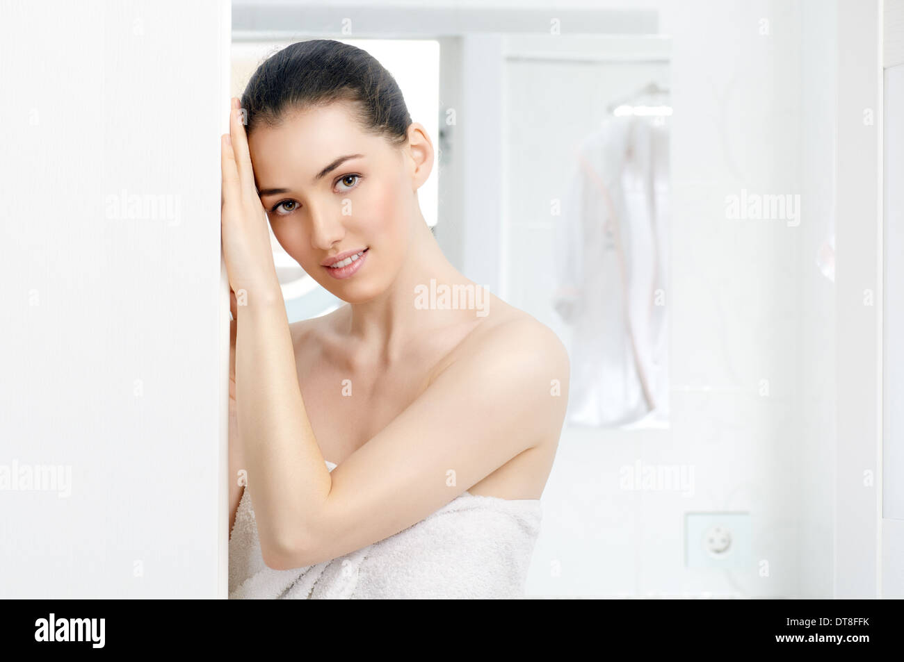 girl comes out from the bathroom - Stock Image