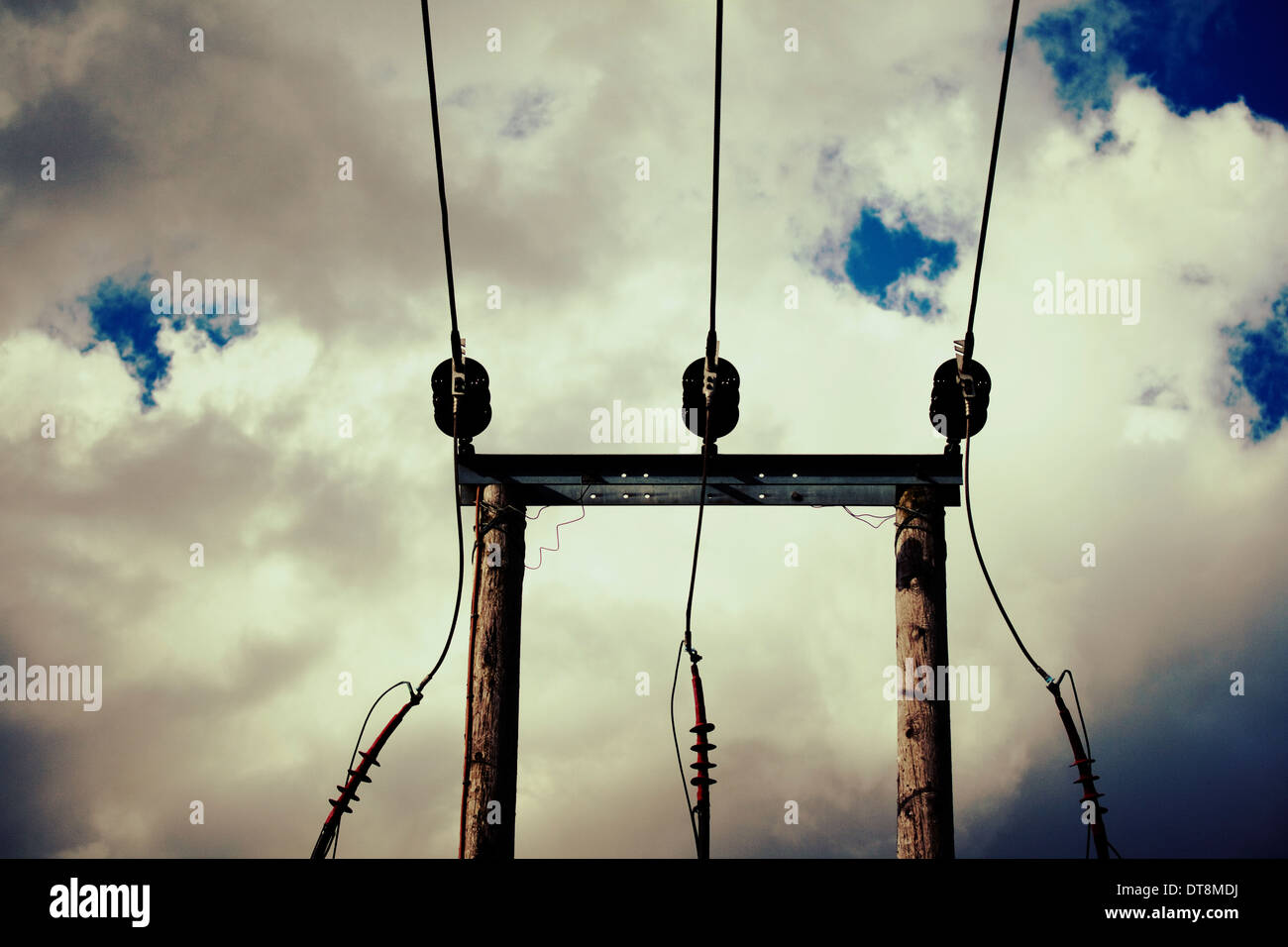 Power cables against a foreboding sky - Stock Image